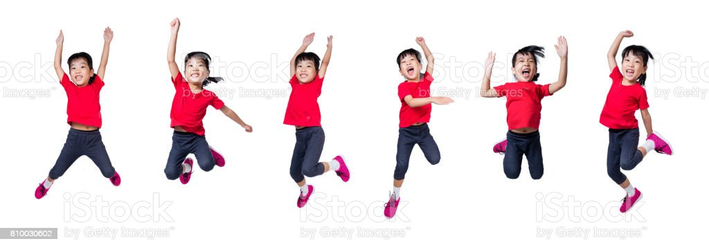 Asian Chinese little girl jumping up and wave her hands stock photo
