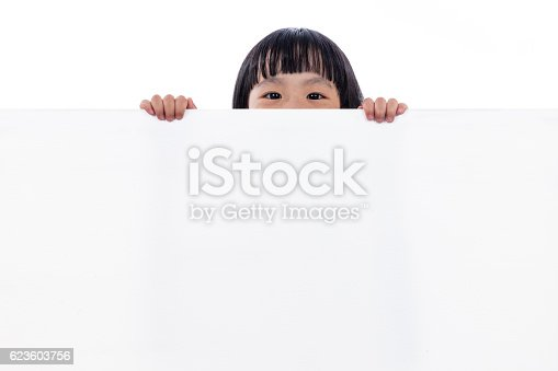 istock Asian Chinese little girl peeping behind white board 623603756