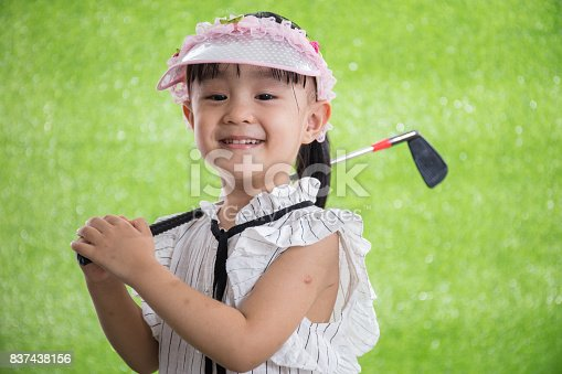 istock Asian Chinese little girl playing golf 837438156