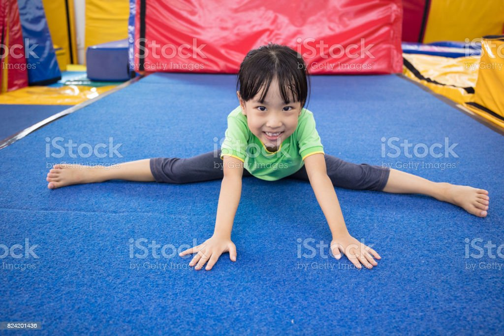 Asian Chinese little girl playing indoor stock photo