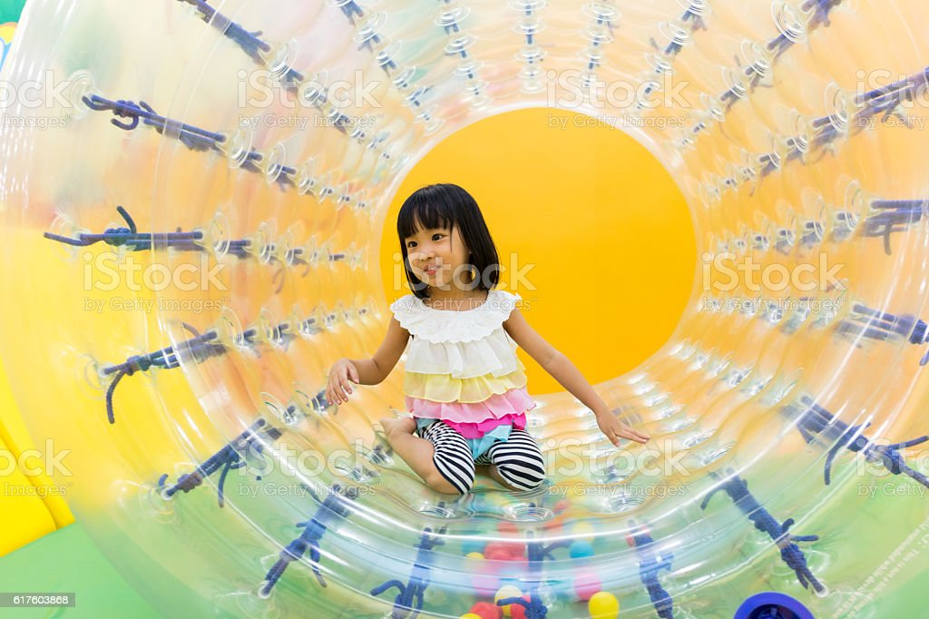 Asian Chinese Little Girl Playing Roller Wheel stock photo
