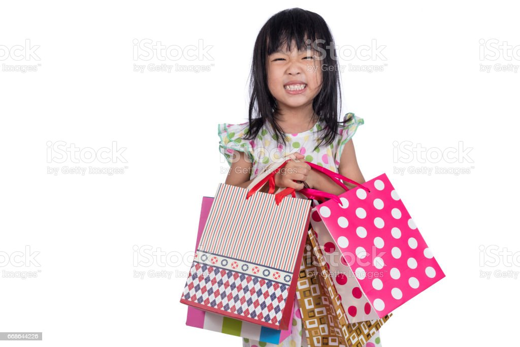 Asian chinese little girl with shopping bags stock photo