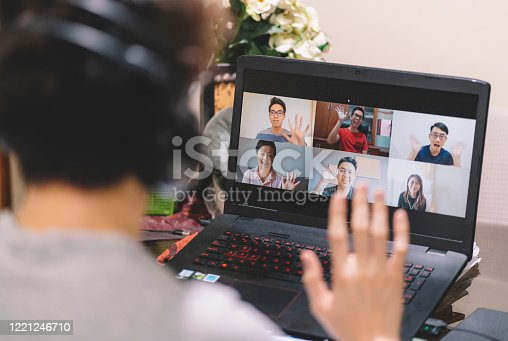 asian chinese male having online video conference with friends