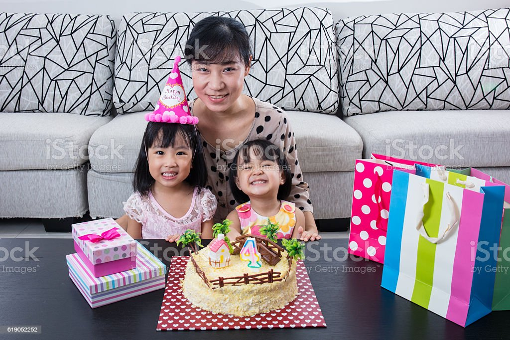 Asian Chinese Mom And Daughter With Celebrating Birthday Stock Photo