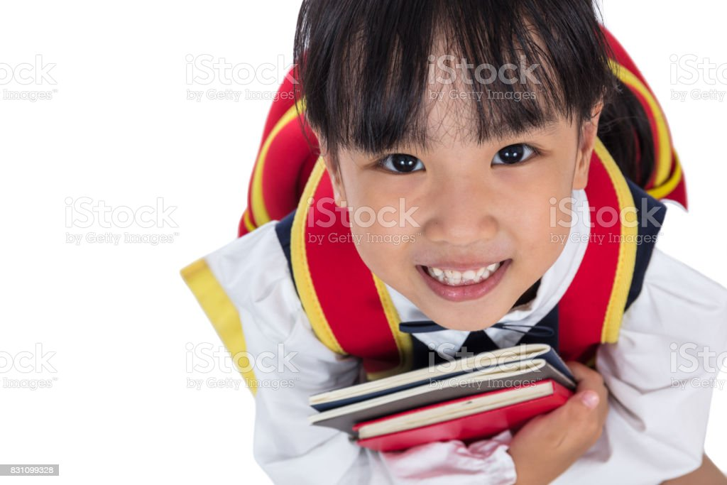 Asian Chinese primary school girl sitting on the floor royalty-free stock  photo a25285272e56d