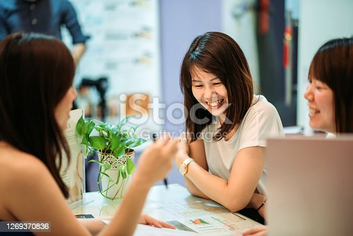 female customer toothy smile when beautician talking with them