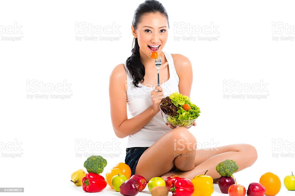 Asian Chinese woman eating healthy salad stock photo