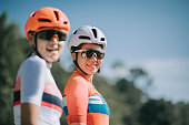 istock 2 Asian chinese women road bike cyclist portrait 1283946203