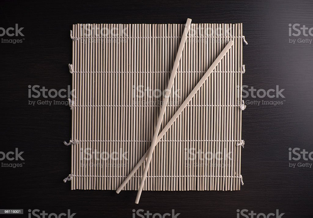 Asian chopsticks on bamboo royalty-free stock photo