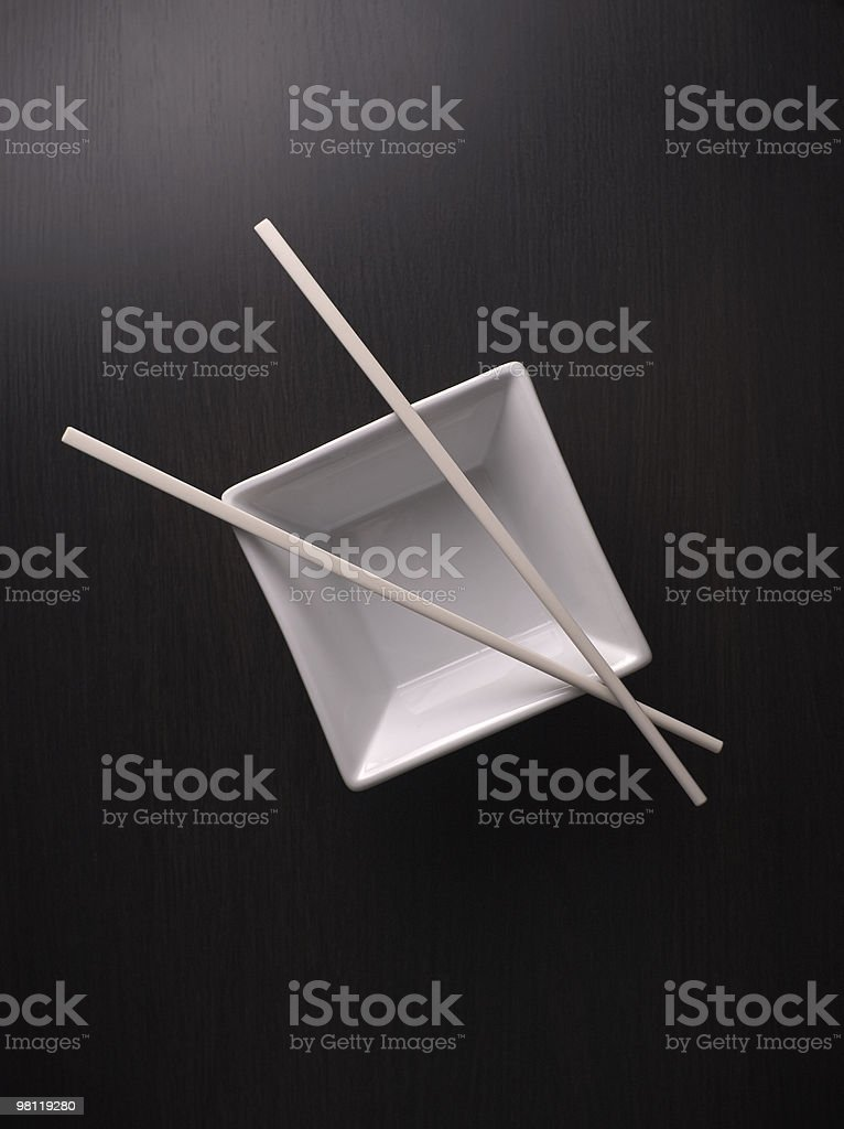 Asian chopsticks with rice bowl royalty-free stock photo