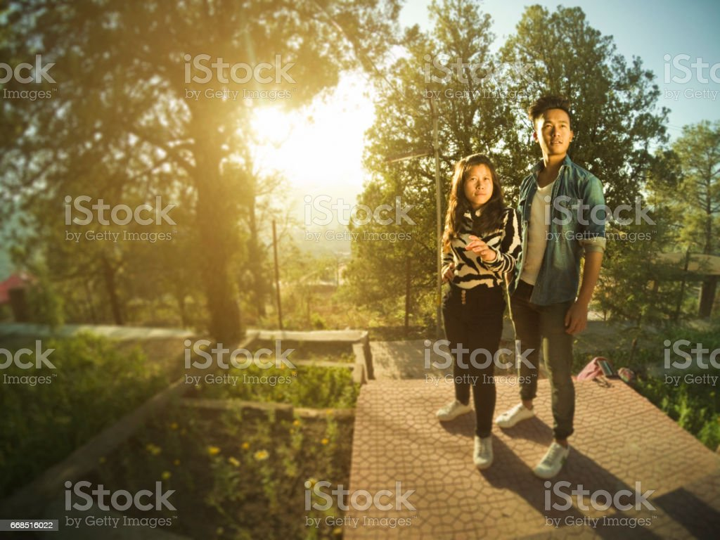 Asian college friends standing together in a park. stock photo