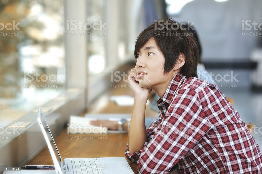 Asian College Student Daydreaming royalty-free stock photo