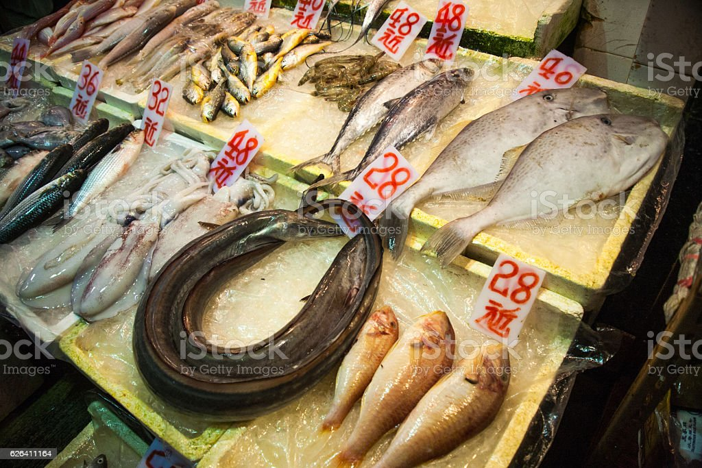 Asian counter to the fish market stock photo