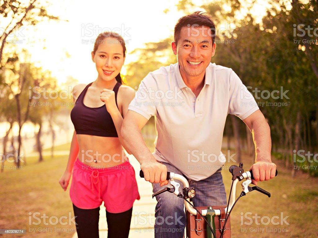 asian couple enjoying outdoor activities stock photo