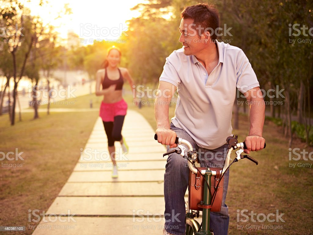 asian couple enjoying outdoor activities stock photo