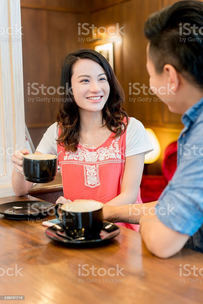 Asian couple having a cup of coffee royalty-free stock photo