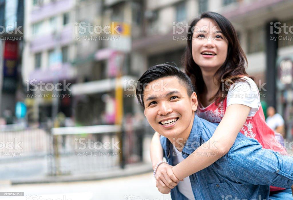 Asian couple having fun outdoors royalty-free stock photo