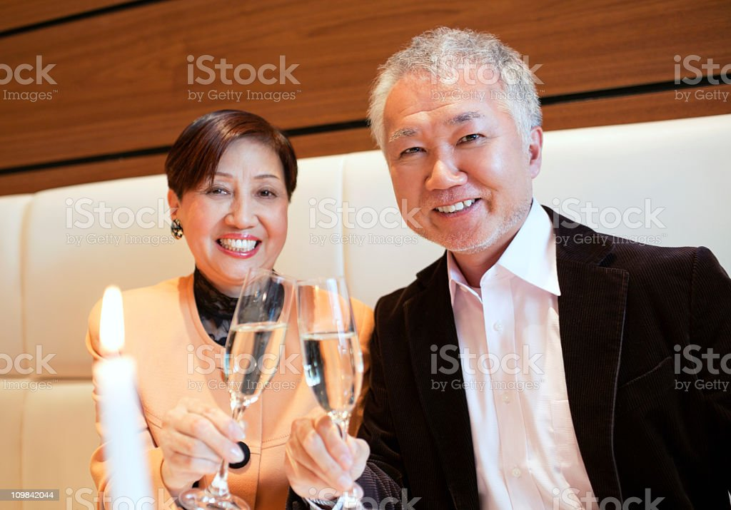 asian couple in a restaurant royalty-free stock photo