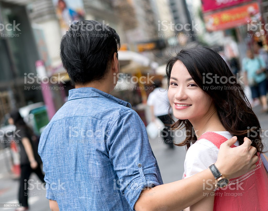 Asian couple in the streets of Hong Kong royalty-free stock photo