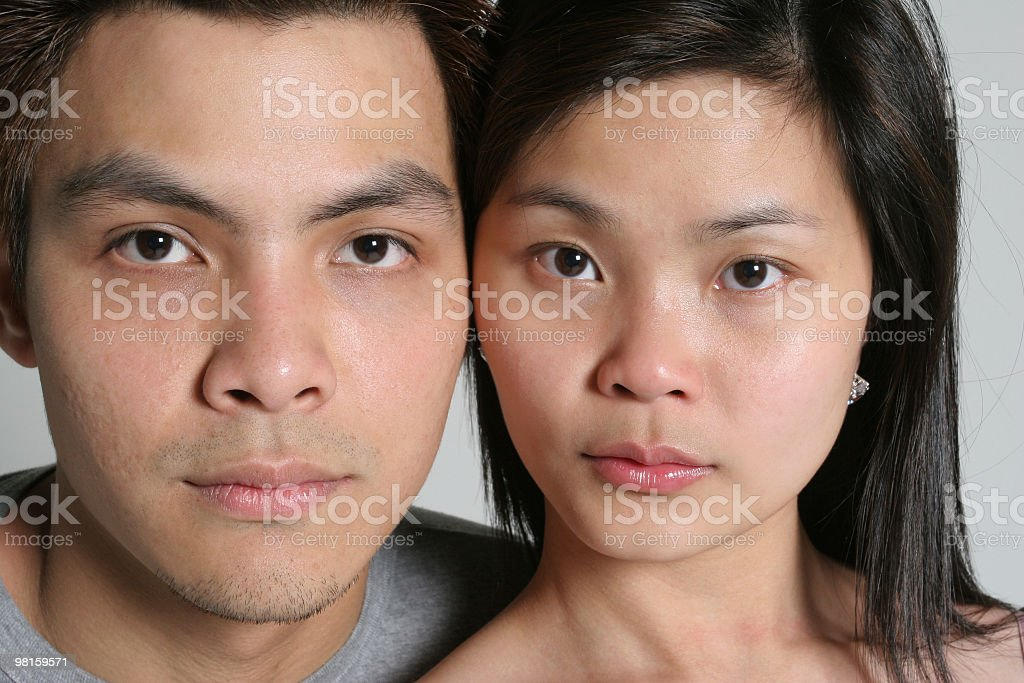 Asian couple looking at you royalty-free stock photo