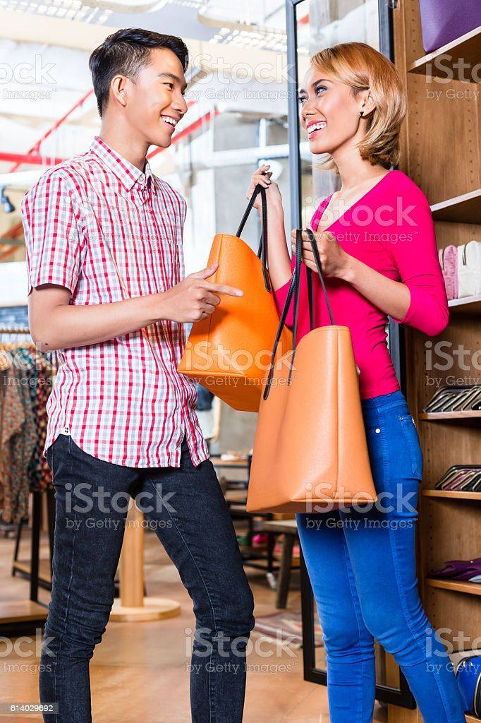 ea3a548136 Asian couple shopping in fashion store or shop royalty-free stock photo