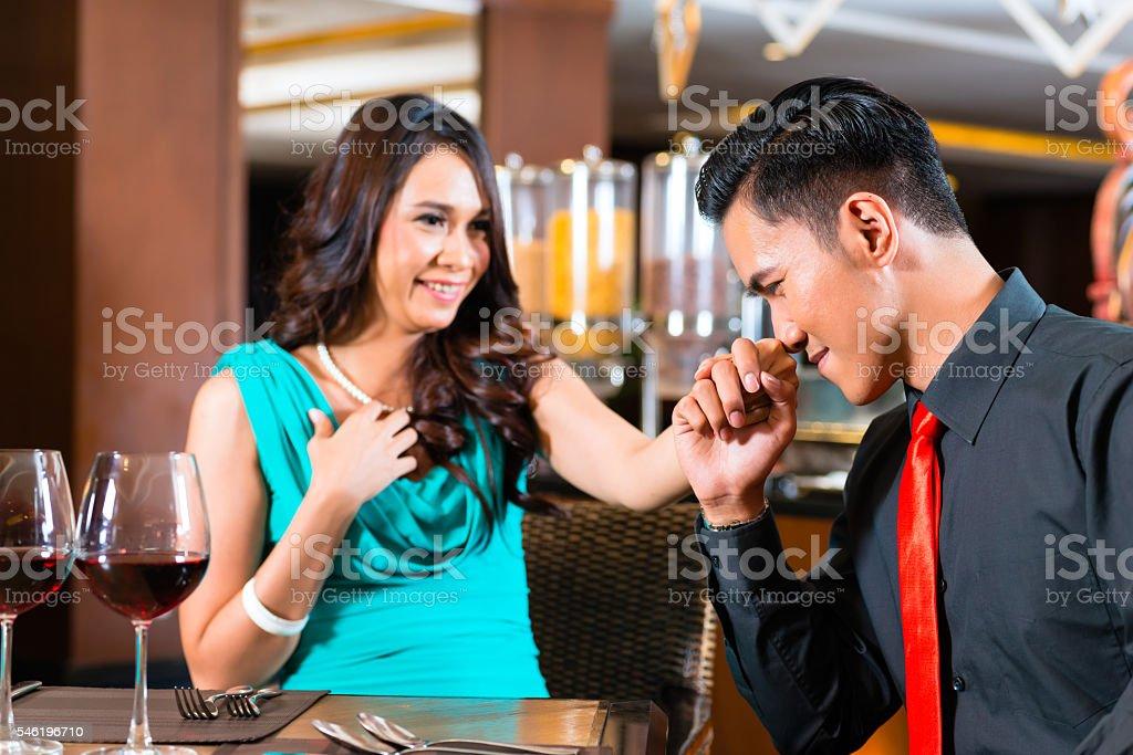 Asian couple sitting in restaurant stock photo