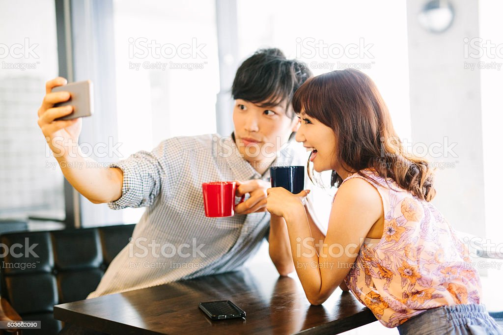 Asian Couple taking a Selfie stock photo