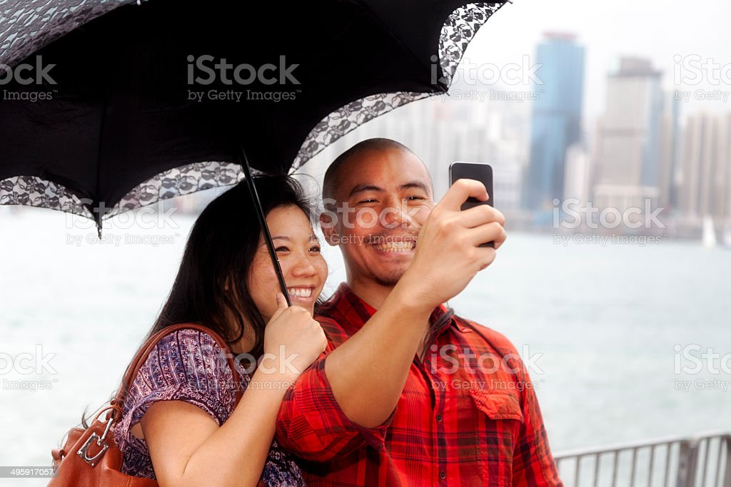 Asian couple taking selfie stock photo