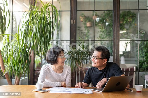 Asian couple talking about buying a new house.