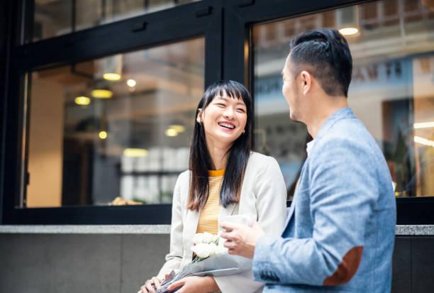 Asian couple talking happily stock photo
