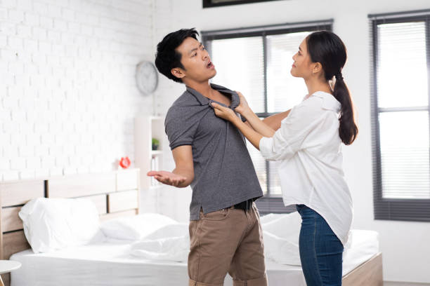 Asian couple, they are bored and arguing unhappy. Asian couple, they are bored and arguing unhappy. background of the sad couple fighting bed stock pictures, royalty-free photos & images