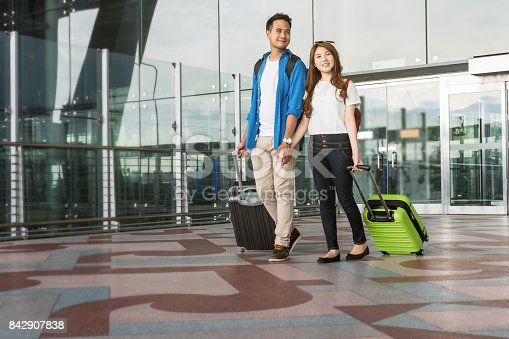 istock Asian couple traveler with suitcases at the airport. Lover travel and transportation with technology concept. 842907838
