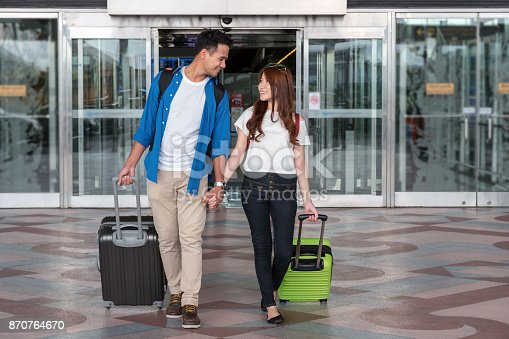 istock Asian couple traveler with suitcases at the airport. Lover travel and transportation with technology concept. 870764670