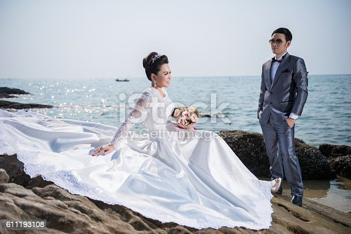 Asian Couple Wearing Wedding Dress And Suit For Beach Wedding Stock ...