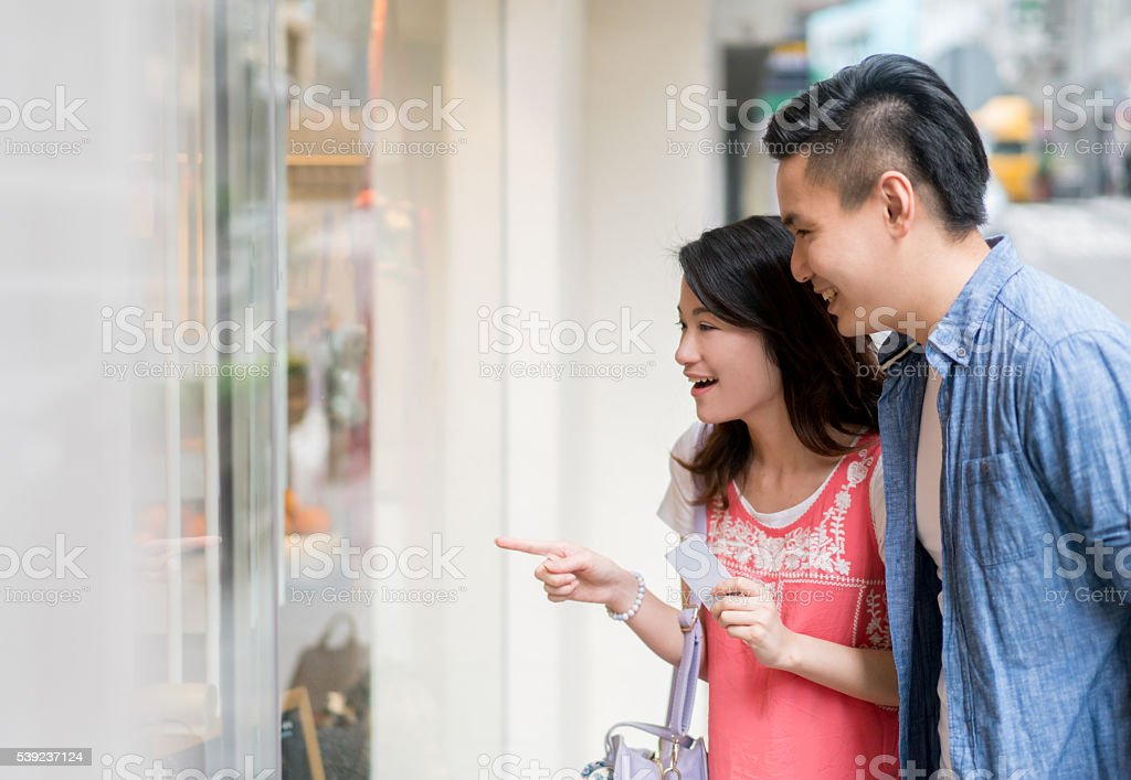 Asian couple window shopping royalty-free stock photo