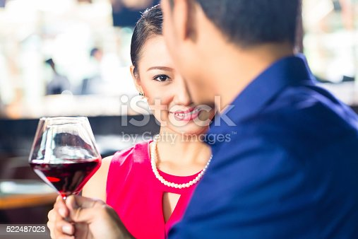 istock Asian couple with wine in Restaurant 522487023