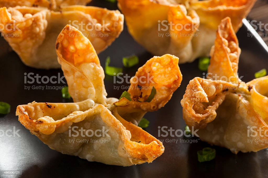 Asian Crab Rangoons with Sweet and Sour Sauce stock photo