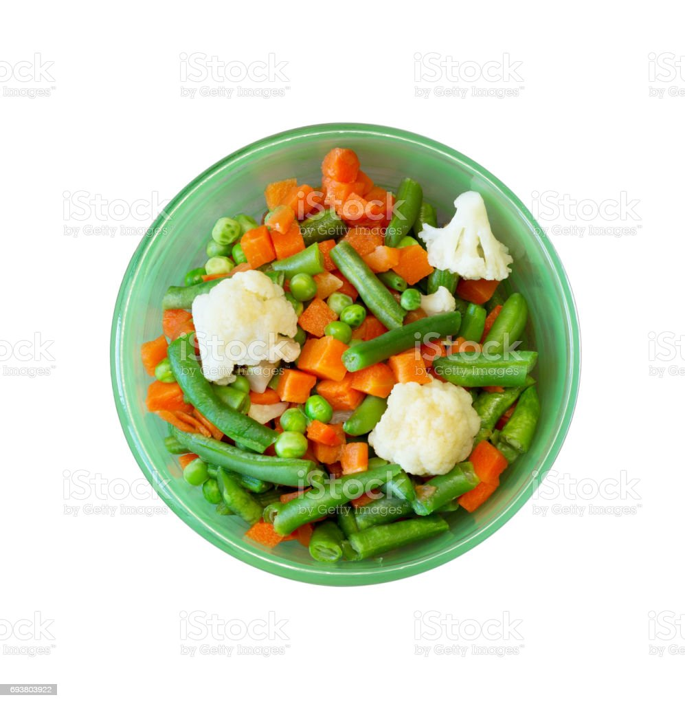 Asian cuisine. vegetable mix of carrots, peas, green beans and cauliflower in green plate, close-up view from above isolated on white background stock photo