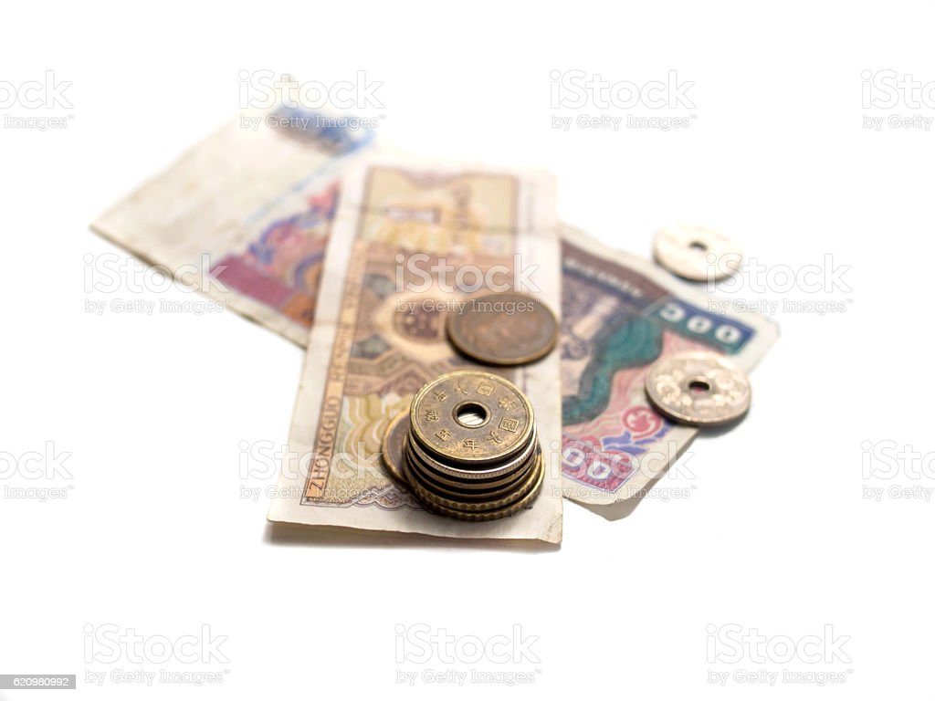 Asiática moedas e notas de banco de moeda foto royalty-free