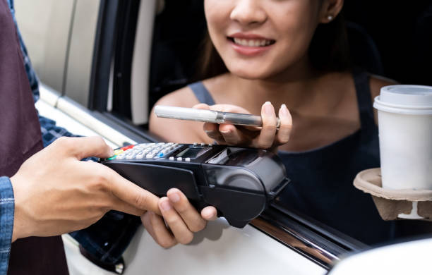 Asian customer make contactless mobile payment Drive thru stock photo