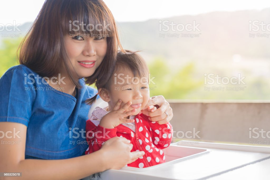 Asian cute baby girl and beautiful mother enjoyful on mountain background. zbiór zdjęć royalty-free