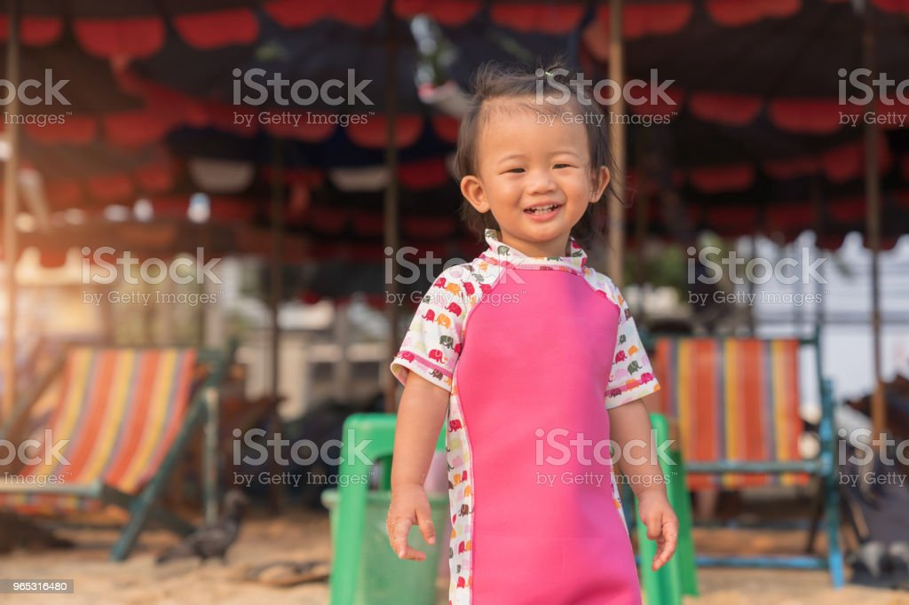 Asian cute baby girl smiling on the beach background. zbiór zdjęć royalty-free