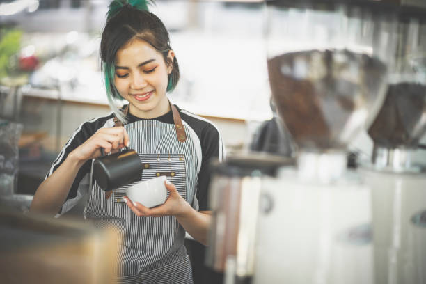 Asian cute barista woman making coffee in the coffee shop Asian cute barista woman making coffee in the coffee shop barista stock pictures, royalty-free photos & images