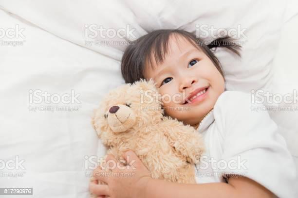 Asian cute little child girl hugging teddy bear in bed picture id817290976?b=1&k=6&m=817290976&s=612x612&h=twrerb50ue9oxxy4nkqlw4lmm cqi92u9sseltafok0=