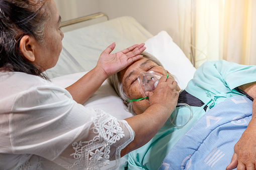 1049772134 istock photo Asian daughter visiting her mother lying in bed at hospital room 944069250