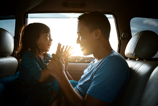 istock asian daughter with father in the car playing 1148992008