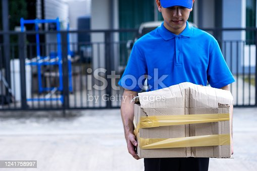 800345184 istock photo Asian delivery man in blue uniform he emotional falling courier courier showing damaged box, cheap parcel delivery, poor shipment quality. 1241758997