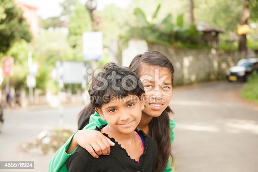istock Asian descent girl friends posing in downtown city streets. 485576924