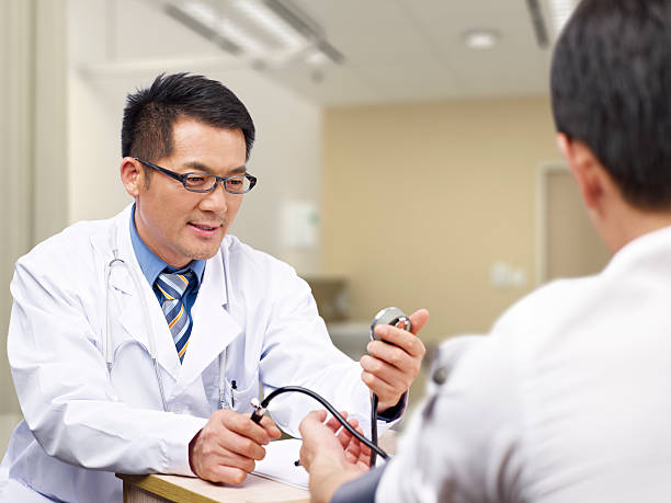 asian doctor and patient - outpatient stock pictures, royalty-free photos & images