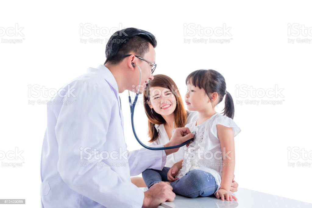 Asian doctor examining a girl by stethoscope stock photo